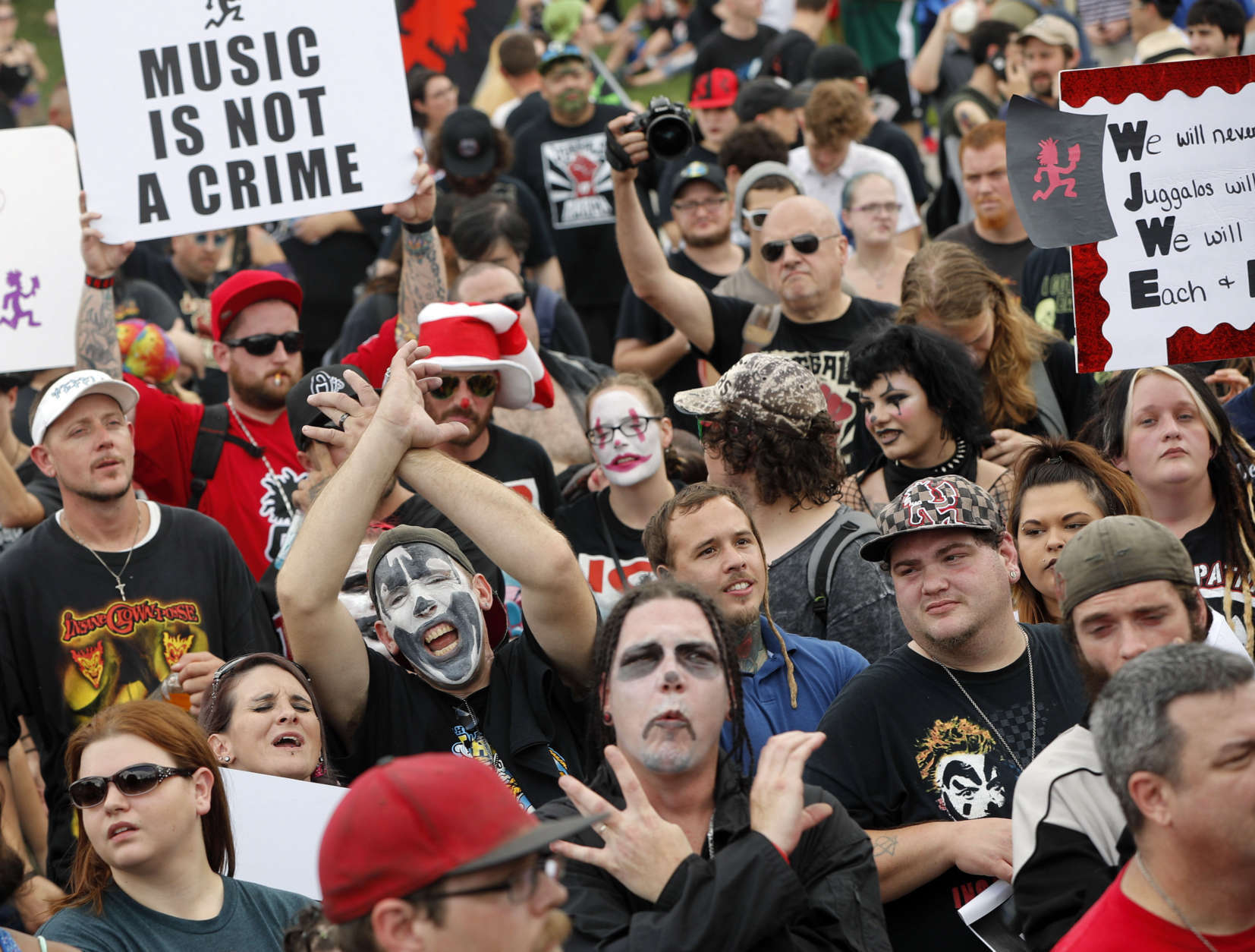 """Juggalos, as supporters of the rap group Insane Clown Posse are known, gather in front of the Lincoln Memorial in Washington during a rally, Saturday, Sept. 16, 2017, to protest and demand that the FBI rescind its classification of the juggalos as """"loosely organized hybrid gang."""" (AP Photo/Pablo Martinez Monsivais)"""
