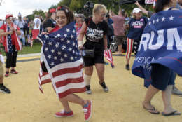 """People gather on the National Mall in Washington, Saturday, Sept. 16, 2017, to attend a rally in support of President Donald Trump in what organizers are calling 'The Mother of All Rallies."""" (AP Photo/Susan Walsh)"""