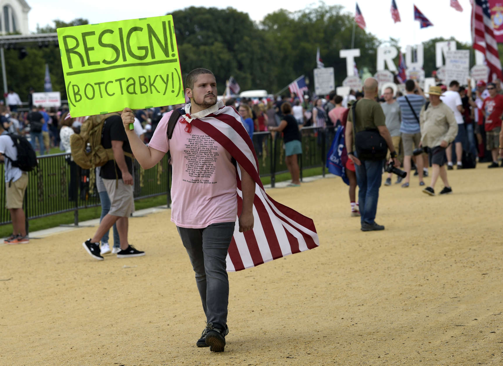 """A man carries a sign as he walks through a rally on the National Mall in Washington, Saturday, Sept. 16, 2017, in support of President Donald Trump in what organizers are calling 'The Mother of All Rallies."""" (AP Photo/Susan Walsh)"""