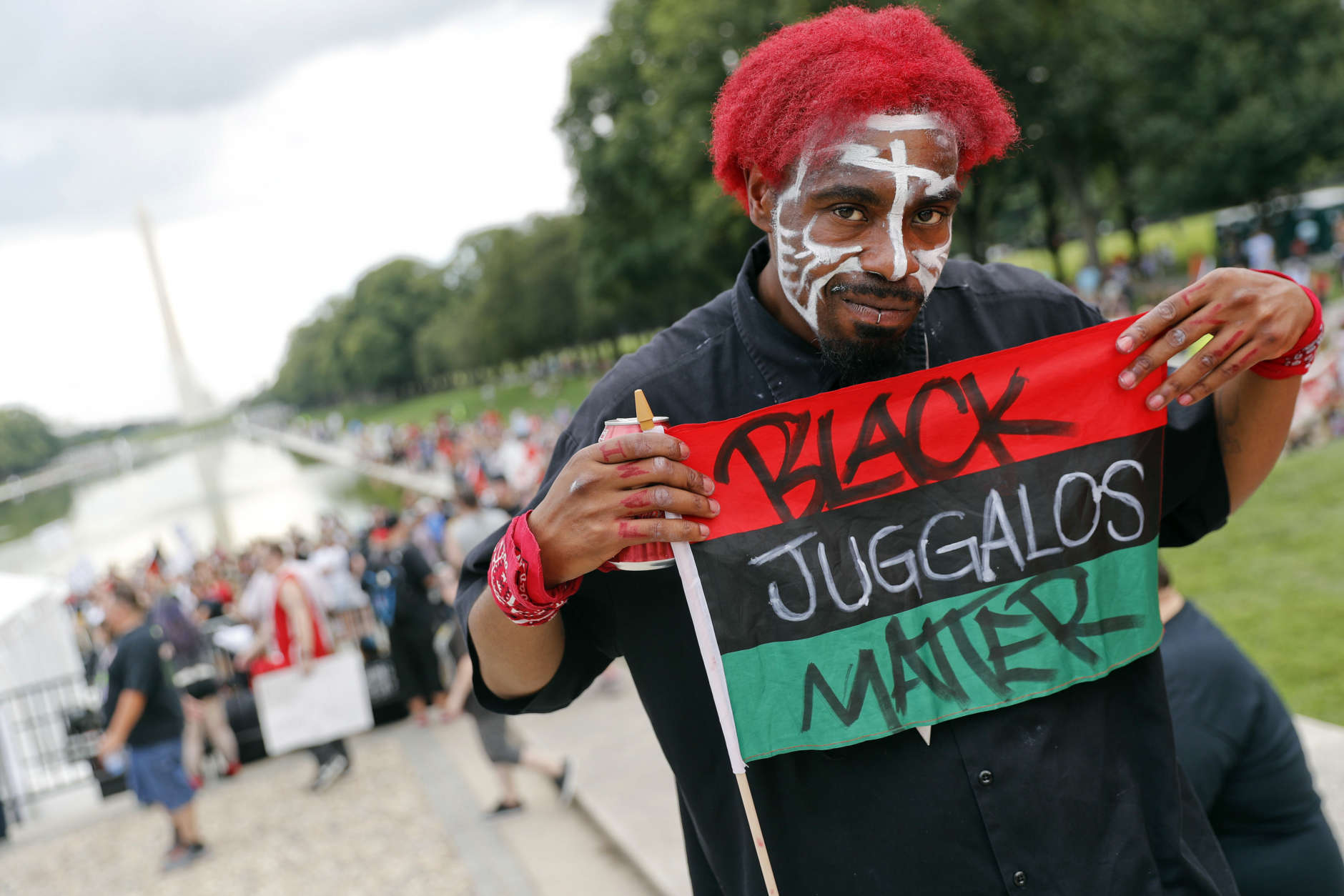 """Richard Williams, 29, of Oakland, Calif., joins other juggalos, as supporters of the rap group Insane Clown Posse are known, in front of the Lincoln Memorial in Washington during a rally, Saturday, Sept. 16, 2017, to protest and demand that the FBI rescind its classification of the juggalos as """"loosely organized hybrid gang."""" (AP Photo/Pablo Martinez Monsivais)"""