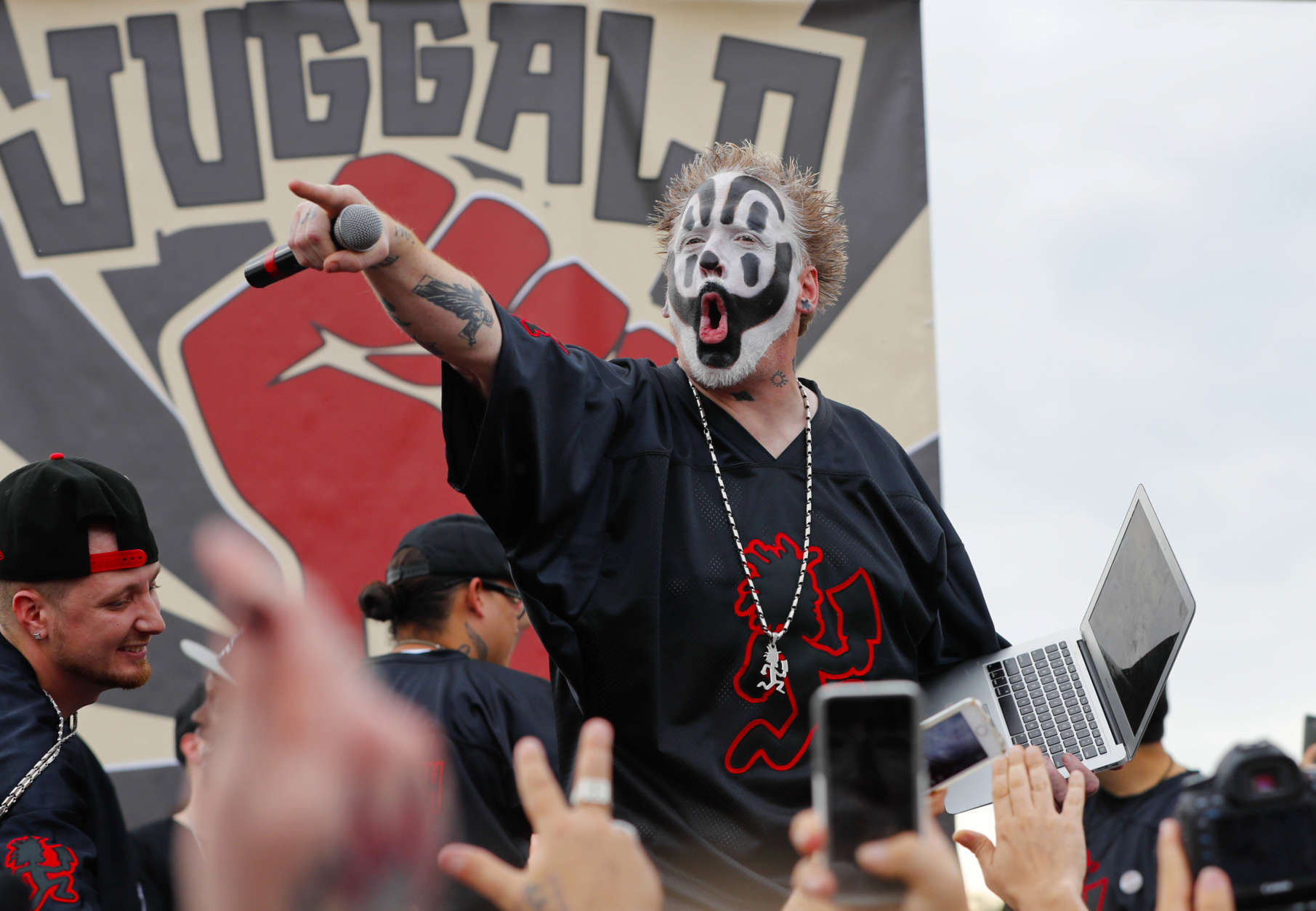 """Violent J, a member of the rap group Insane Clown Posse, yells on stage before speaking to juggalos, as supporters of the group are known, in front of the Lincoln Memorial in Washington during a rally, Saturday, Sept. 16, 2017, to protest and demand that the FBI rescind its classification of the juggalos as """"loosely organized hybrid gang."""" (AP Photo/Pablo Martinez Monsivais)"""
