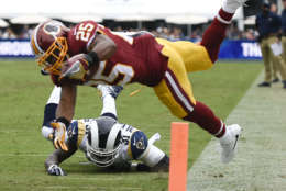 Washington Redskins running back Chris Thompson scores past Los Angeles Rams strong safety Maurice Alexander during the first half of an NFL football game Sunday, Sept. 17, 2017, in Los Angeles.(AP Photo/Kelvin Kuo)