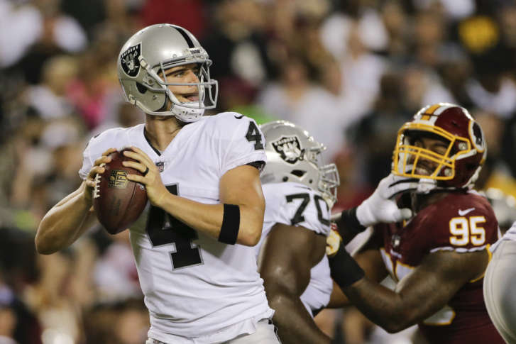 Oakland Raiders quarterback Derek Carr (4) looks for an opening to pass  during the first half of an NFL football game against the Washington  Redskins in ... 3f25a4daa