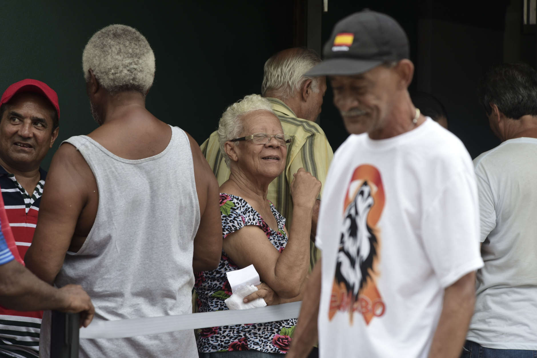 Clients of Coopaca Coperative wait in line to withdraw cash from their accounts after the passage of Hurricane Maria a week ago, in Catano, Puerto Rico, Wednesday, Sept. 27, 2017. The cooperative only granted 200 turns to remove a maximum of one hundred dollars per customer. Banks are either closed, on limited hours or are short on cash and many people can't go back to work. It's compounding what is already a difficult situation on the island. (AP Photo/Carlos Giusti)