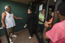 Clients of Coopaca Coperative wait in line to withdraw cash from their accounts after the passage of Hurricane Maria a week ago, in Catano, Puerto Rico, Wednesday, Sept. 27, 2017. The cooperative only granted 200 turns to remove a maximum of one hundred dollars per customer. (AP Photo/Carlos Giusti)