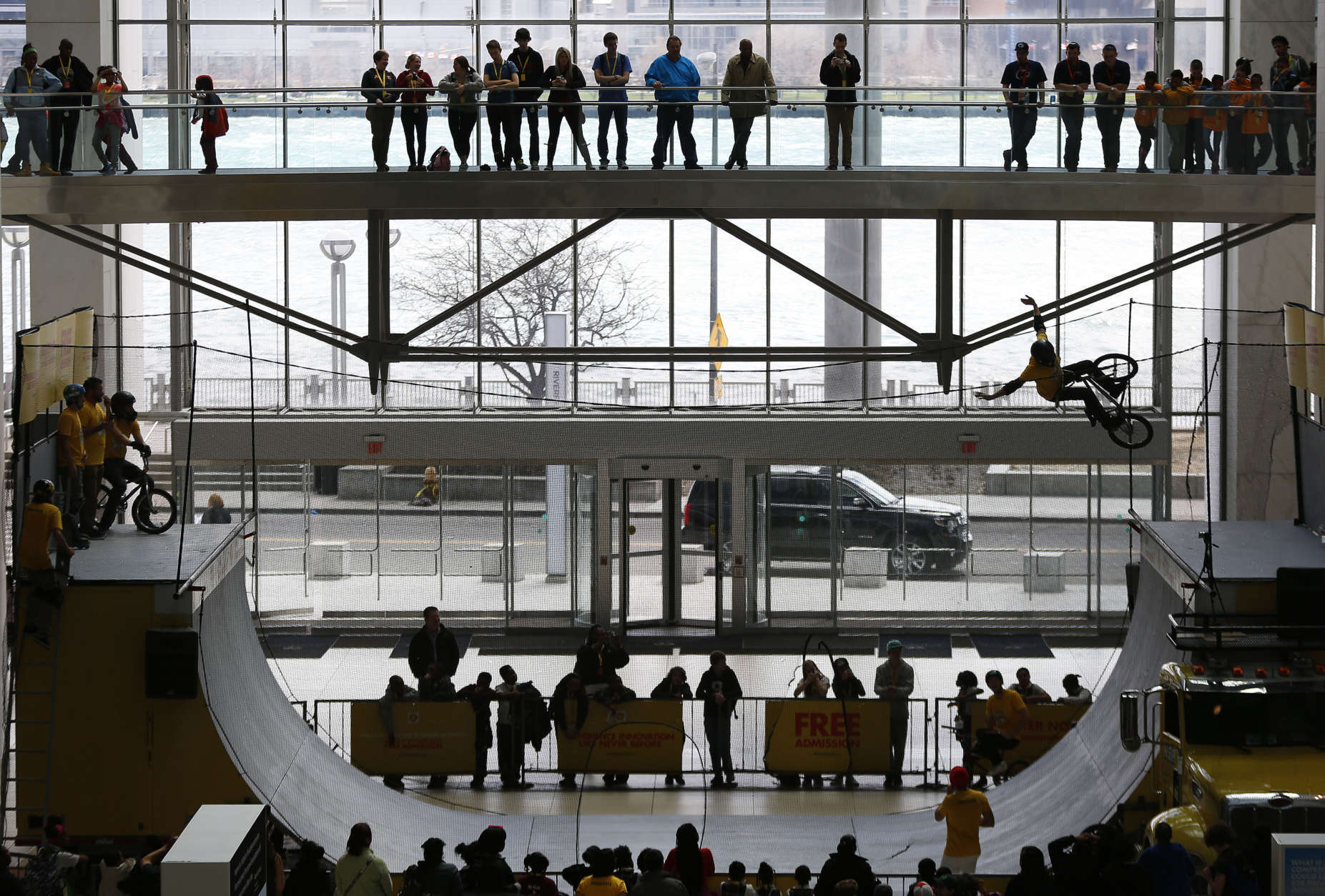Spectators watch a cyclist perform on a half pipe at COBO Center in conjunction with the Shell Eco-marathon Americas competition in Detroit Friday, April 10, 2015. (AP Photo/Paul Sancya)