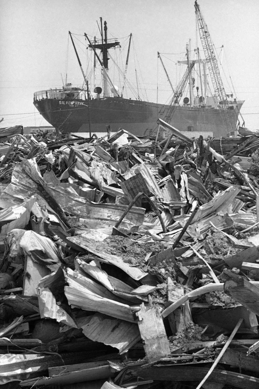 The freighter silver hawk, beached at Gulfport, Miss., on August 3, 1970 by hurricane Camille, appears to be adrift on a sea of debris. The silver hawk was one of two cargo ships run aground by the 200-mile-per-hour hurricane. Both, still there almost a year later, are yielding to the blowtorch as crews dismantle them. (AP Photo/Jack Thornell)