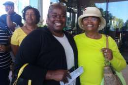 """Bernadette Crosson (left) and her mother Helen James (right) visit the museum on Saturday. """"To witness this on the anniversary weekend, it's such a fantastic feeling,"""" said James, a 14-year cancer survivor. """"Seventy one-years old, born 1946 ... I was born during segregation ... to come here and experience this museum is just tearful."""" (WTOP/Kathy Stewart)"""