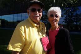 """Russ and Betty Minton visited the museum from Florida. """"The history is always emotionally trying for anybody that goes through,"""" said Betty. """"It brings tears to your eyes, always."""" Even so, she says she is happy with the museum and the way it is presenting African American history """"because more and more people will see it and understand, and that's important."""" (WTOP/Kathy Stewart)"""