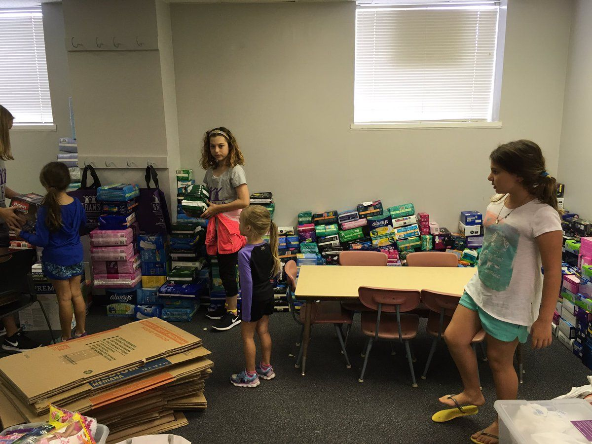 Volunteers included adults, preteens and even younger children. They sorted through donations. (WTOP/Liz Anderson)