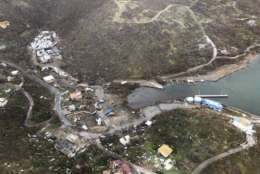 CORRECTS DAY - This photo provided on Friday, Sept. 8, 2017, shows storm damage in the aftermath of Hurricane Irma in Virgin Gorda's Gun Creek in the British Virgin Islands. Irma scraped Cuba's northern coast Friday on a course toward Florida, leaving in its wake a ravaged string of Caribbean resort islands strewn with splintered lumber, corrugated metal and broken concrete. (Caribbean Buzz Helicopters via AP)