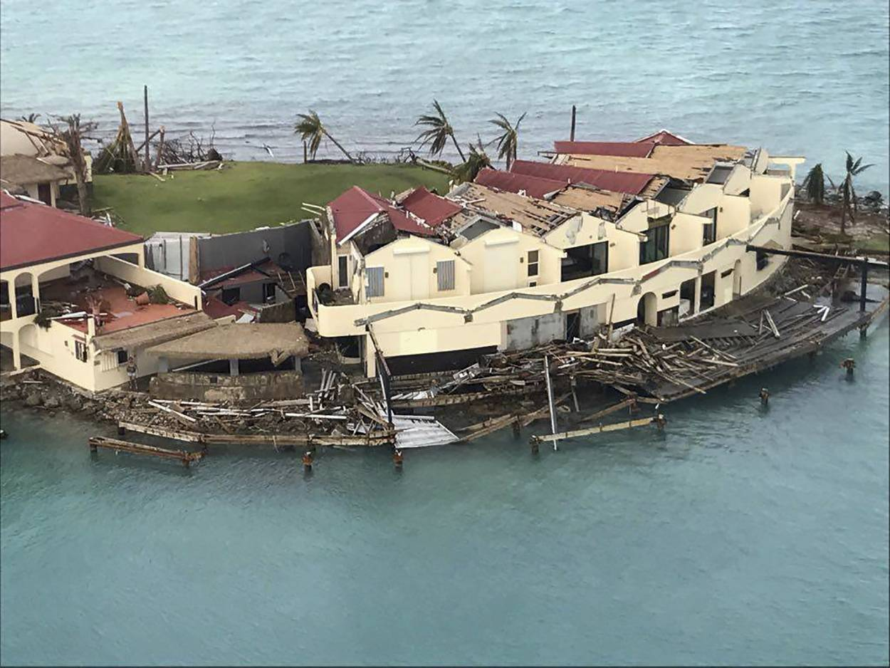 CORRECTS DAY - This photo provided on Friday, Sept. 8, 2017, shows storm damage in the aftermath of Hurricane Irma in Virgin Gorda's Saba Rock in the British Virgin Islands. Irma scraped Cuba's northern coast Friday on a course toward Florida, leaving in its wake a ravaged string of Caribbean resort islands strewn with splintered lumber, corrugated metal and broken concrete. (Caribbean Buzz Helicopters via AP)