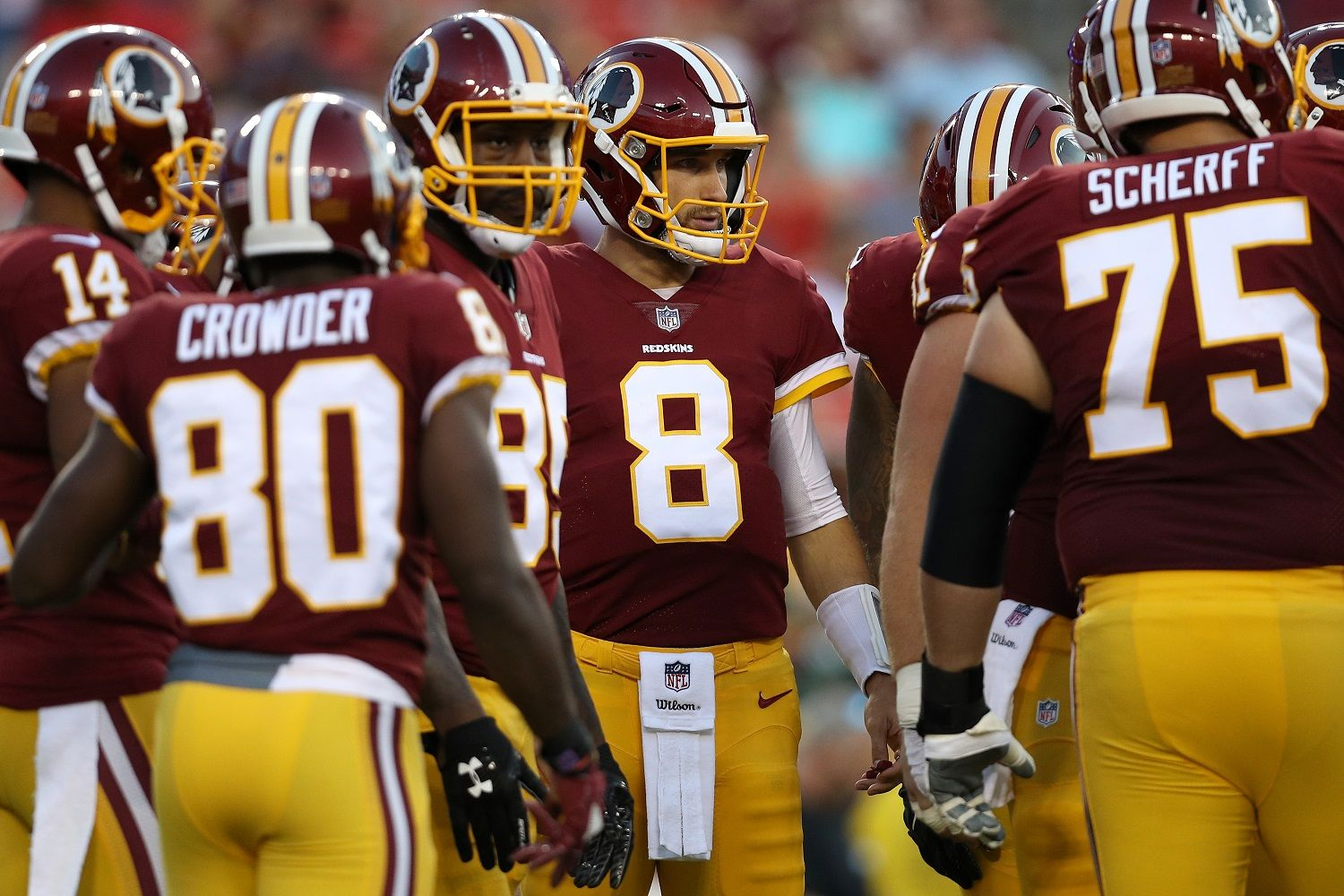 LANDOVER, MD - AUGUST 19: Quarterback Kirk Cousins #8 of the Washington Redskins stands in the huddle against the Green Bay Packers in the first half during a preseason game at FedExField on August 19, 2017 in Landover, Maryland. (Photo by Patrick Smith/Getty Images)