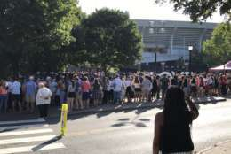 The crowd at Scott Stadium's East Gate waiting to get into the venue. (WTOP/Michelle Basch)
