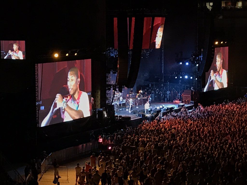 """""""I'm in Virginia right now.  I'm home!""""  said Pharrell Williams.  He had the audience dancing and singing along to """"Happy."""" (WTOP/Michelle Basch)"""