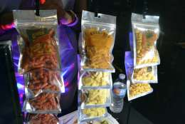 "In this Sept. 11, 2017, photo,  a display of Creatos, Weed-Itz and Flavorblaster marijuana infused edibles in Washington, at a closed Ethiopian restaurant at a ""gifted"" marijuana event. In the so-called ""District of Cannabis"" it's legal to grow and consume marijuana, but illegal to buy or sell it. The result of this unique legal grey area has spawned a thriving cottage industry of businesses using the ""gifting"" loophole. So far the city government and police are letting it happen. (AP Photo/P. Solomon Banda)"