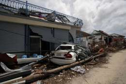 View of the damaged houses destroyed by Irma during the visit of France's President Emmanuel Macron in the French Caribbean islands of St. Martin, Tuesday, Sept. 12, 2017. Macron is in the French-Dutch island of St. Martin, where 10 people were killed on the French side and four on the Dutch. (AP Photo/Christophe Ena, Pool)