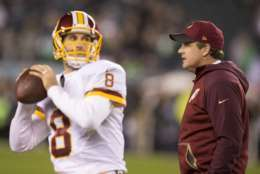 PHILADELPHIA, PA - DECEMBER 26: Kirk Cousins #8 of the Washington Redskins warms up as head coach Jay Gruden walks past him prior to the game against the Philadelphia Eagles on December 26, 2015 at Lincoln Financial Field in Philadelphia, Pennsylvania.  (Photo by Mitchell Leff/Getty Images)