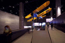 WASHINGTON, DC - SEPTEMBER 14: The Spirit of Tuskegee, a PT-13 Stearman biplane flown by Tuskegee Airmen training to fight in WWII, hangs from the ceiling above the concourse galleries at the Smithsonian's National Museum of African American History and Culture on the National Mall September 14, 2016 in Washington, DC. Filled with exhibits and artifacts telling the story of the first Africans in the United States and their descendents, the 400,000-square-foot museum will open to the public on September 24. (Photo by Chip Somodevilla/Getty Images)