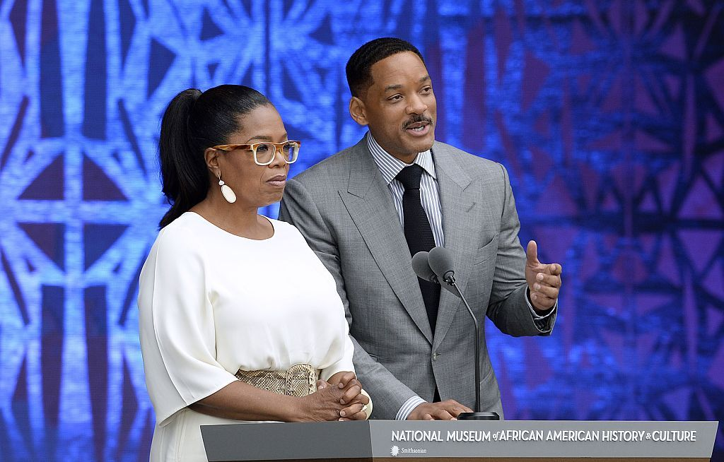 WASHINGTON, DC - SEPTEMBER 24:   Oprah Winfrey, and Will Smith speak at the opening ceremony of the Smithsonian National Museum of African American History and Culture on September 24, 2016 in Washington, DC. The museum is opening thirteen years after Congress and President George W. Bush authorized its construction.   (Photo by Olivier Douliery-Pool/Getty Images)