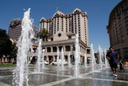 SAN JOSE, CA - AUGUST 29:  People play in a fountain outside of the Fairmont Hotel August 29, 2007 in downtown San Jose, California. The U.S. Census Bureau released its newest population survey today and named San Jose, California as the richest city in the United States with a population of 500,000 or more. The median household income in San Jose is $74,000. San Francisco, California and San Diego, California were second and third followed by Seattle, Washington and Las Vegas, Nevada.  (Photo by Justin Sullivan/Getty Images)