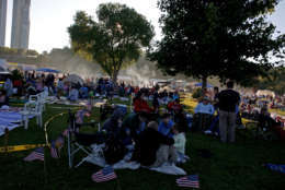 MILWAUKEE - JULY 3:  People gather for a July Fourth fireworks show on the shore of Lake Michigan July 3, 2008 in downtown Milwaukee, Wisconsin.  The city traditionally has its celebration on July 3 so as not to compete with the celebrations of the surrounding communities.  (Photo by Darren Hauck/Getty Images)