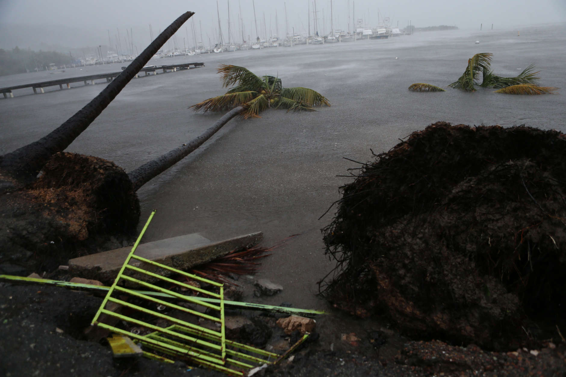 FAJARDO, PUERTO RICO - SEPTEMBER 06: Debris is seen during a storm surge near the Puerto Chico Harbor during the passing of Hurricane Irma on September 6, 2017 in Fajardo, Puerto Rico. The category 5 storm is expected to pass over Puerto Rico and the Virgin Islands today, and make landfall in Florida by the weekend. (Photo by Jose Jimenez/Getty Images)