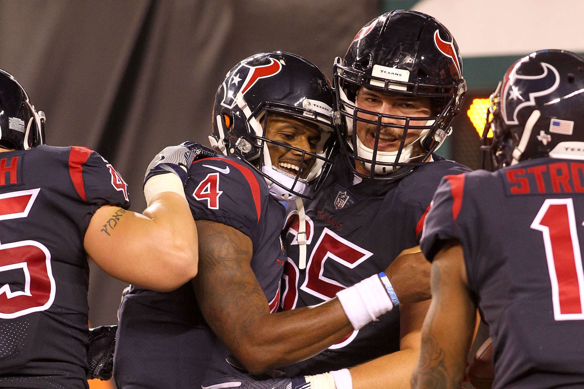 CINCINNATI, OH - SEPTEMBER 14:  Deshaun Watson #4 of the Houston Texans celebrates with Greg Mancz #65 after scoring a touchdown against the Cincinnati Bengals during the first half at Paul Brown Stadium on September 14, 2017 in Cincinnati, Ohio.  (Photo by John Grieshop/Getty Images)