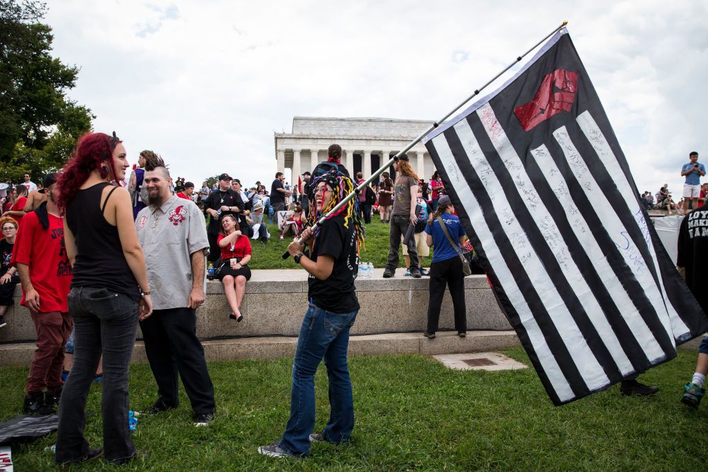 WASHINGTON, DC - SEPTEMBER 16: People gather for a rally before the start of the Juggalo March, at the Lincoln Memorial on the National Mall, September 16, 2017 in Washington, DC. Fans of the band Insane Clown Posse, known as Juggalos, are protesting their identification as a gang by the FBI in a 2011 National Gang Threat Assessment. (Photo by Al Drago/Getty Images)