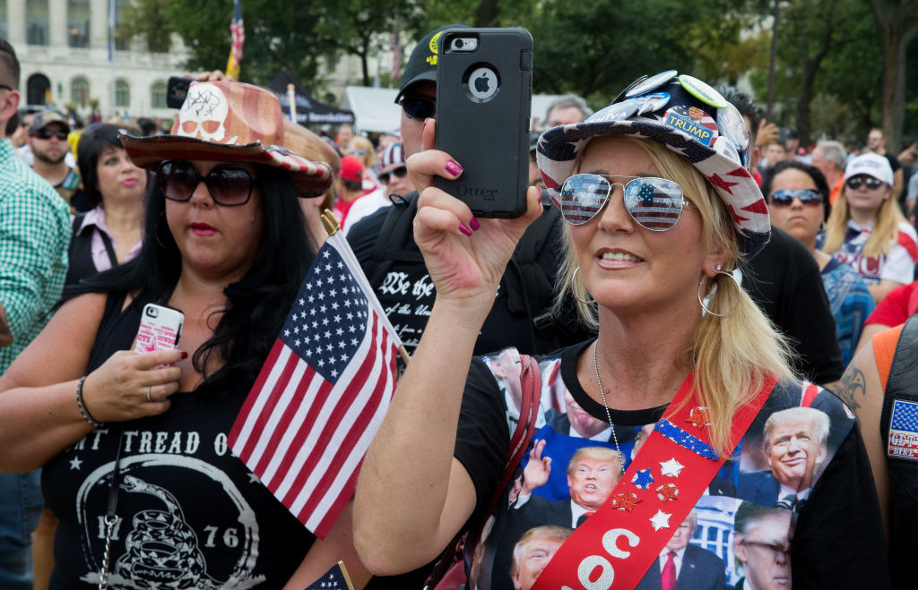 """WASHINGTON, DC - SEPTEMBER 16: Pro-Trump supporters during the national anthem on the National mall on September 16, 2017 in Washington, DC.  Organizers are calling the rally in support of President Donald Trump  """"The Mother of All Rallies"""",  President Trump is in New Jersey ahead of attending the U.N. General Assembly next week.  (Photo by Tasos Katopodis/Getty Images)"""
