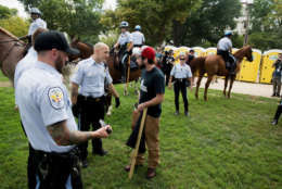 """WASHINGTON, DC - SEPTEMBER 16:  US Park Service Police take away a fixed blade hunting knife from a man at the Pro-Trump Rally on the National Mall on September 16, 2017 in Washington, DC.   Organizers are calling the rally in support of President Donald Trump  """"The Mother of All Rallies"""",  President Trump is in New Jersey ahead of attending the U.N. General Assembly next week.  (Photo by Tasos Katopodis/Getty Images)"""