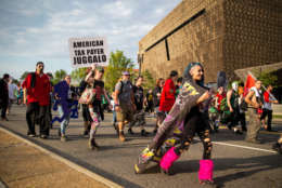 WASHINGTON, DC - SEPTEMBER 16:  Marchers walk past the National Museum of African American History and Culture, during the Juggalo March, on the National Mall, September 16, 2017 in Washington, DC. Fans of the band Insane Clown Posse, known as Juggalos, are protesting their identification as a gang by the FBI in a 2011 National Gang Threat Assessment. (Photo by Al Drago/Getty Images)