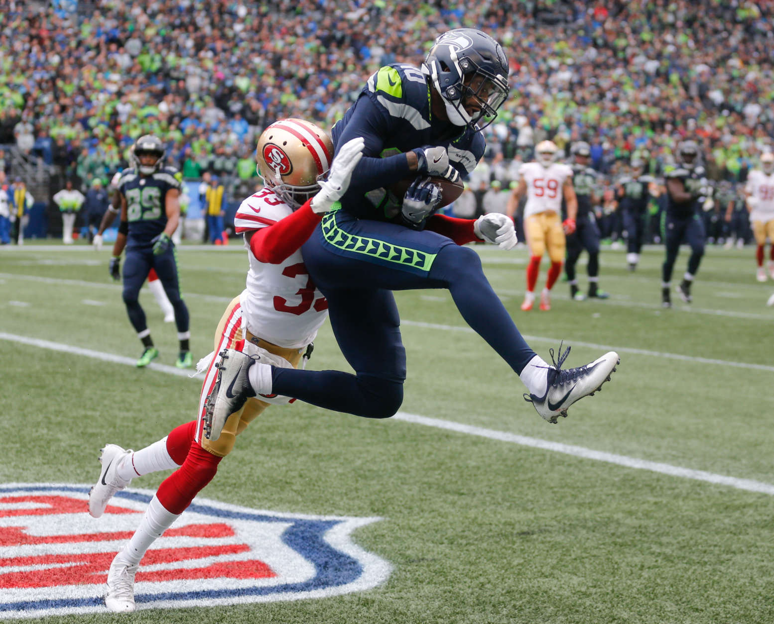 SEATTLE, WA - SEPTEMBER 17: Wide receiver Paul Richardson #10 of the Seattle Seahawks beats cornerback Rashard Robinson #33 of the San Francisco 49ers to score a 9 yard touchdown during the fourth quarter of the game at CenturyLink Field on September 17, 2017 in Seattle, Washington. (Photo by Stephen Brashear/Getty Images)