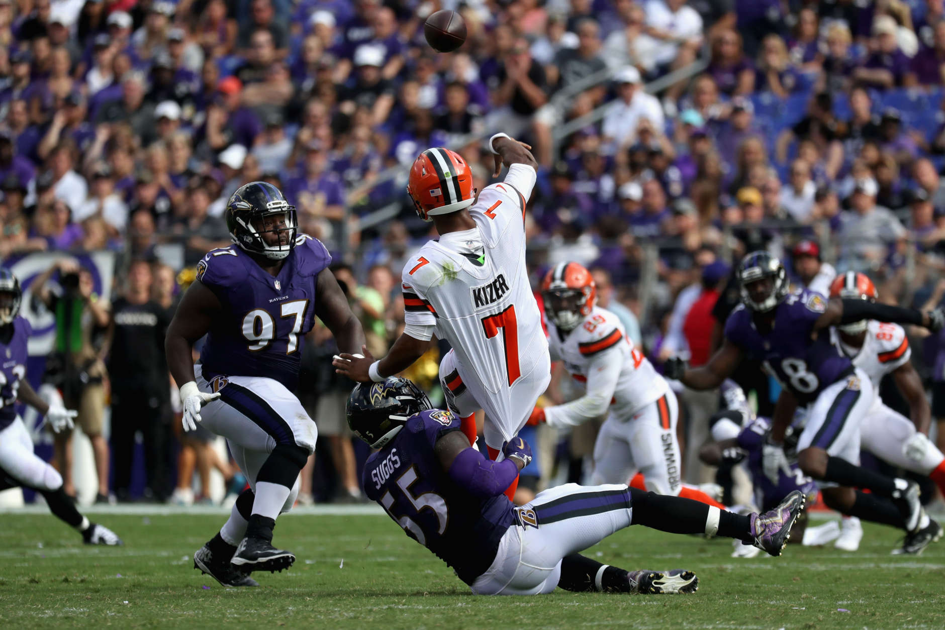 BALTIMORE, MD - SEPTEMBER 17: Quarterback DeShone Kizer #7 of the Cleveland Browns gets off a pass while being tackled by outside linebacker Terrell Suggs #55 of the Baltimore Ravens at M&T Bank Stadium on September 17, 2017 in Baltimore, Maryland.  (Photo by Rob Carr/Getty Images)