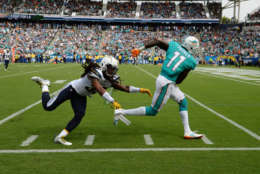 CARSON, CA - SEPTEMBER 17: Wide receiver DeVante Parker #11 of the Miami Dolphins slips past free safety Tre Boston #33 of the Los Angeles Chargers as he makes a catch and runs for big gain during the second half of their NFL game at the StubHub Center September 17, 2017, in Carson, California. (Photo by Kevork Djansezian/Getty Images)