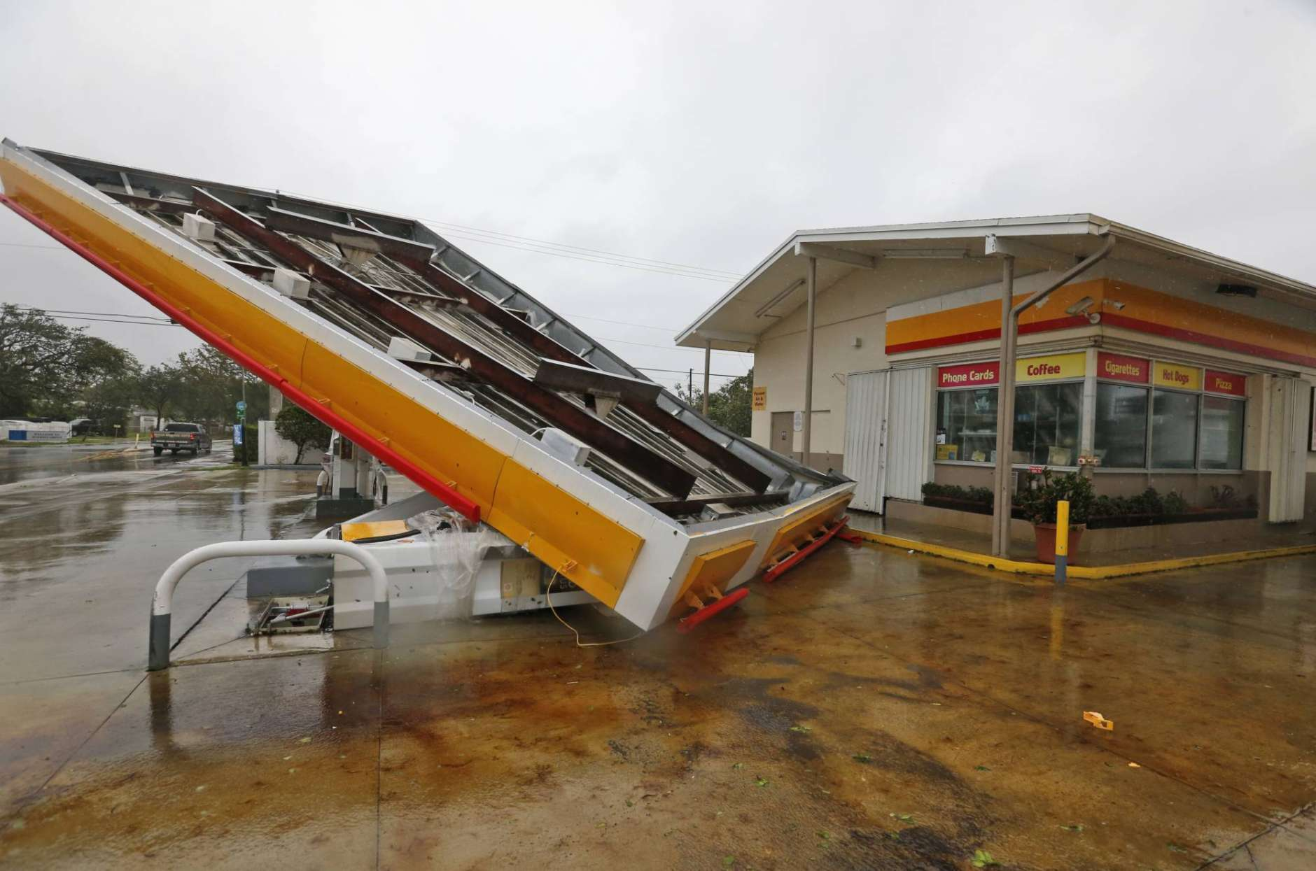 The metal canopy at a gasoline station is shown after it was overturned by high winds brought on by Hurricane Irma, Sunday, Sept. 10, 2017, in North Miami, Fla. (AP Photo/Wilfredo Lee)