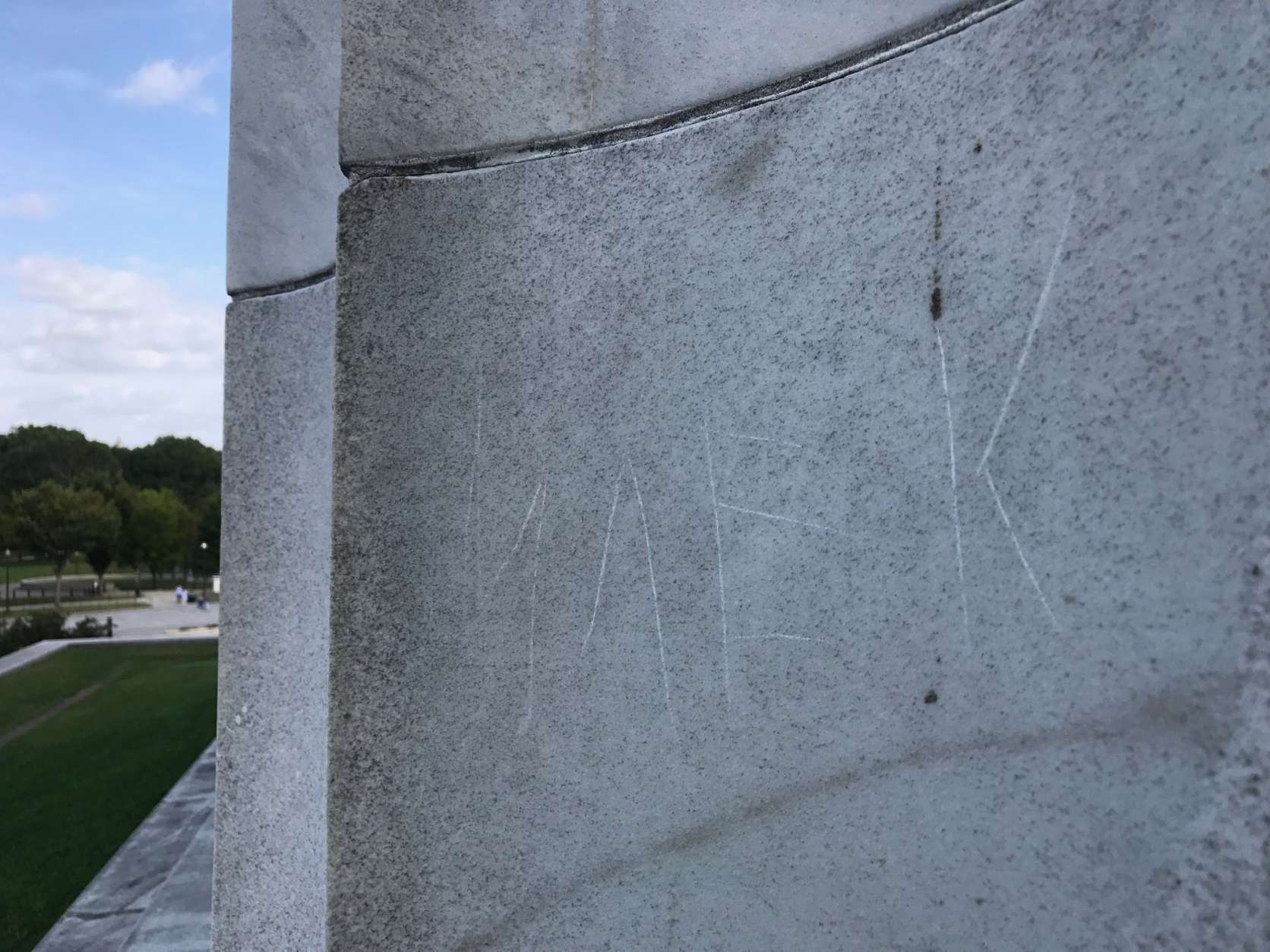 """The letters """"MAEK"""" are seen carved into the side of the Lincoln Memorial Tuesday. A man from the Kyrgyz Republic was arrested Monday on charges of defacing the Lincoln Memorial. National Park officials said the penny he used to etch letters into a stone pillar caused permanent damage. (WTOP/Megan Cloherty)"""