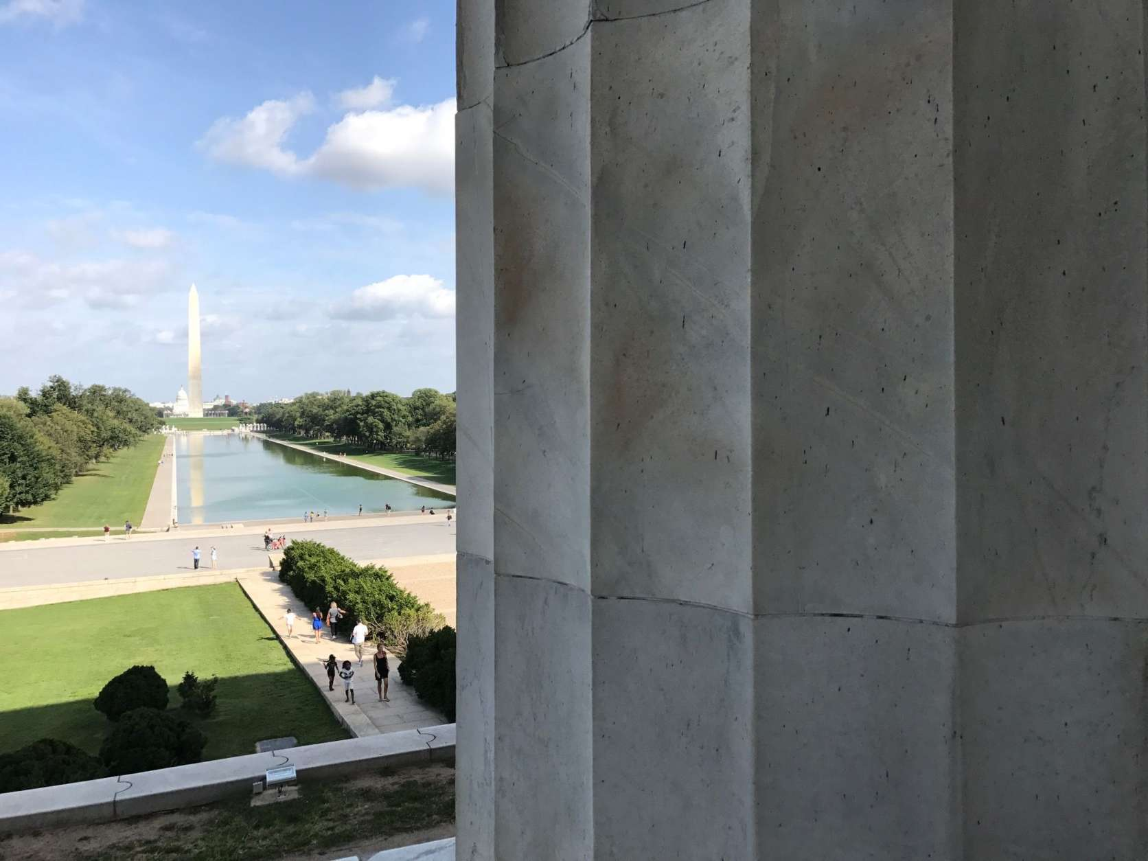 A view from the Lincoln Memorial toward the Washington Monument Tuesday. A man from the Kyrgyz Republic was arrested Monday on charges of defacing the Lincoln Memorial. National Park officials said the penny he used to etch letters into a stone pillar caused permanent damage. (WTOP/Megan Cloherty)