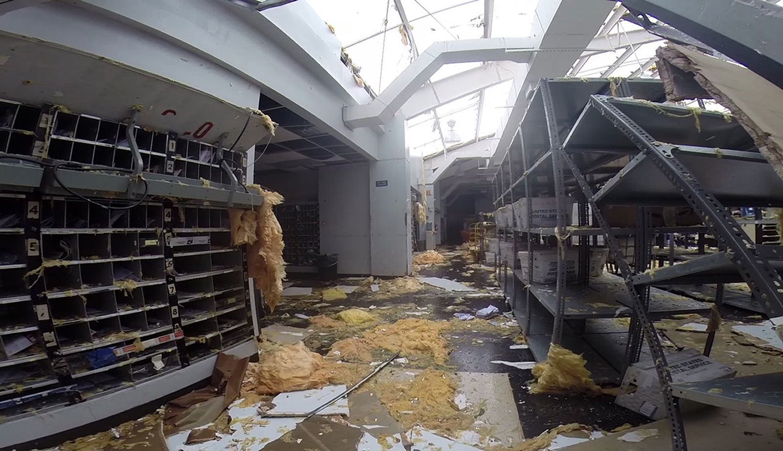 In this image made from video shows a damage to a post office caused by Hurricane Irma in St. Thomas, U.S. Virgin Islands, Thursday, Sept. 7, 2017. Hurricane Irma weakened slightly Thursday with sustained winds of 175 mph, according to the National Hurricane Center. The storm boasted 185 mph winds for a more than 24-hour period, making it the strongest storm ever recorded in the Atlantic Ocean. The storm was expected to arrive in Cuba by Friday. It could hit the Florida mainland by late Saturday, according to hurricane center models. (AP Photo/Ian Brown)