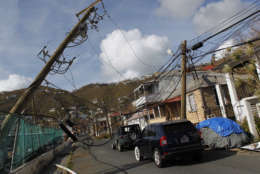 Power lines are damaged after the passage of Hurricane Irma in Charlotte Amalie, St. Thomas, U.S. Virgin Islands, Sunday, Sept. 10, 2017.  The storm ravaged such lush resort islands as St. Martin, St. Barts, St. Thomas, Barbuda and Anguilla. (AP Photo/Ricardo Arduengo)