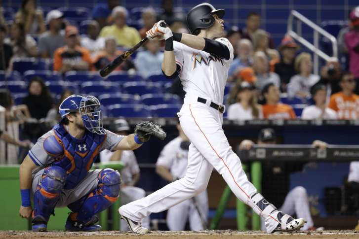 a37fdca9 Miami Marlins' Christian Yelich, right, watches after hitting a solo home  run during the fourth inning of a baseball game against the New York Mets,  ...