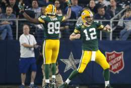 Green Bay Packers quarterback Aaron Rodgers (12) and Jared Cook (89) celebrate after a touchdown during the first half of an NFL divisional playoff football game against the Dallas Cowboys Sunday, Jan. 15, 2017, in Arlington, Texas. (AP Photo/Tony Gutierrez)