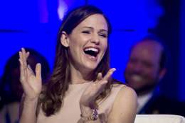 """FILE - In this Feb. 25, 2017, file photo, actress Jennifer Garner reacts to a momentary malfunction of her microphone while addressing the National Governors Association Winter Meeting about early education, in Washington. Garner posted a video of herself on Instagram Sept. 14, 2017, in which she laughs and talks with slurred speech after a dental appointment while emotionally praising a song from the musical """"Hamilton."""" (AP Photo/Cliff Owen, File)"""