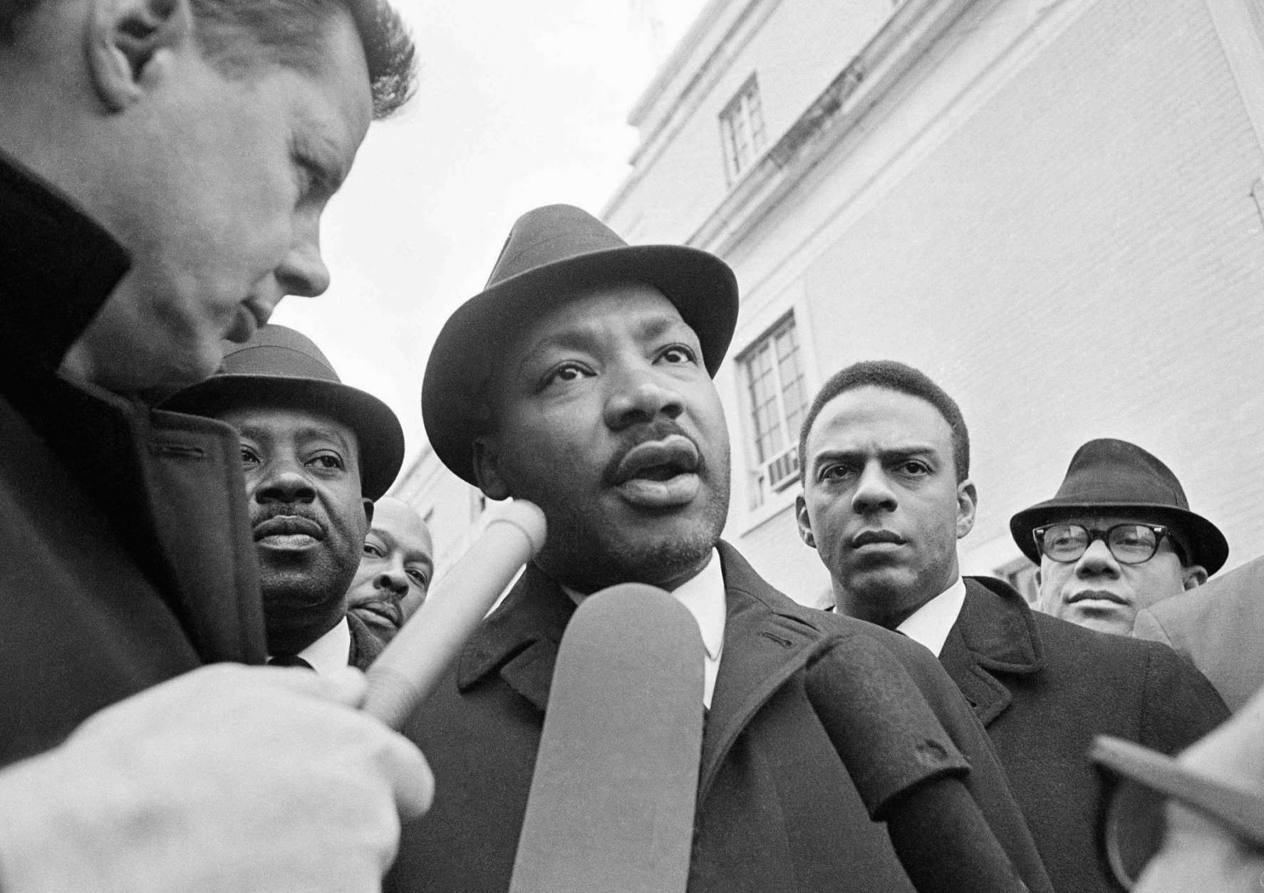 FILE - In this Feb. 5, 1965 file photo, Dr. Martin Luther King Jr. is interviewed by newsmen as he left jail in Selma, Ala. The integration leader was arrested four days ago in a voter registration protest drive. (AP Photo/HC, File)
