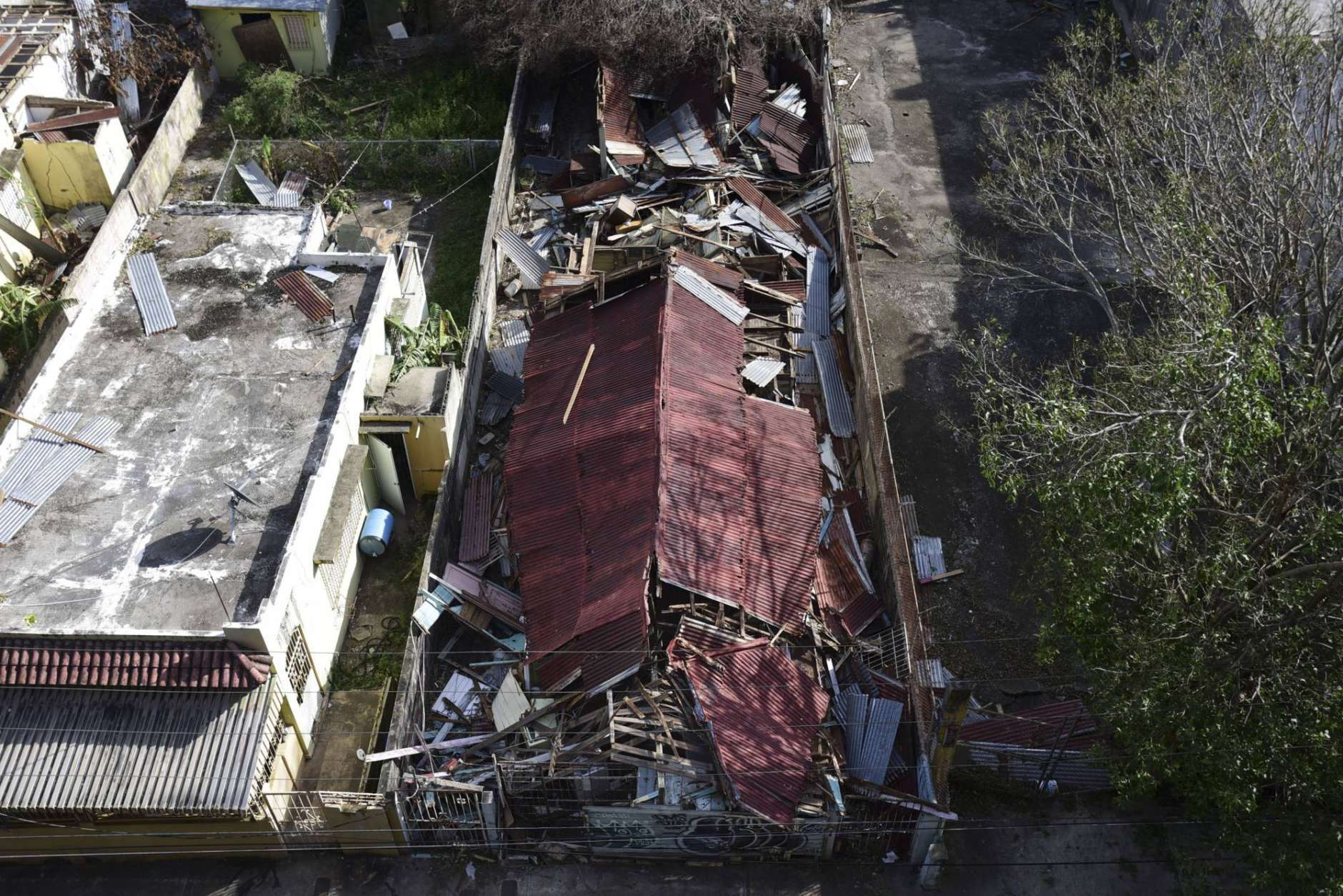 A destroyed building in the of El Gandul Community in Santurce is seen after Hurricane Maria, in San Juan, Puerto Rico, Monday, Sept. 25, 2017. The island territory of more than 3 million U.S. citizens is reeling in the devastating wake of Hurricane Maria. (AP Photo/Carlos Giusti)