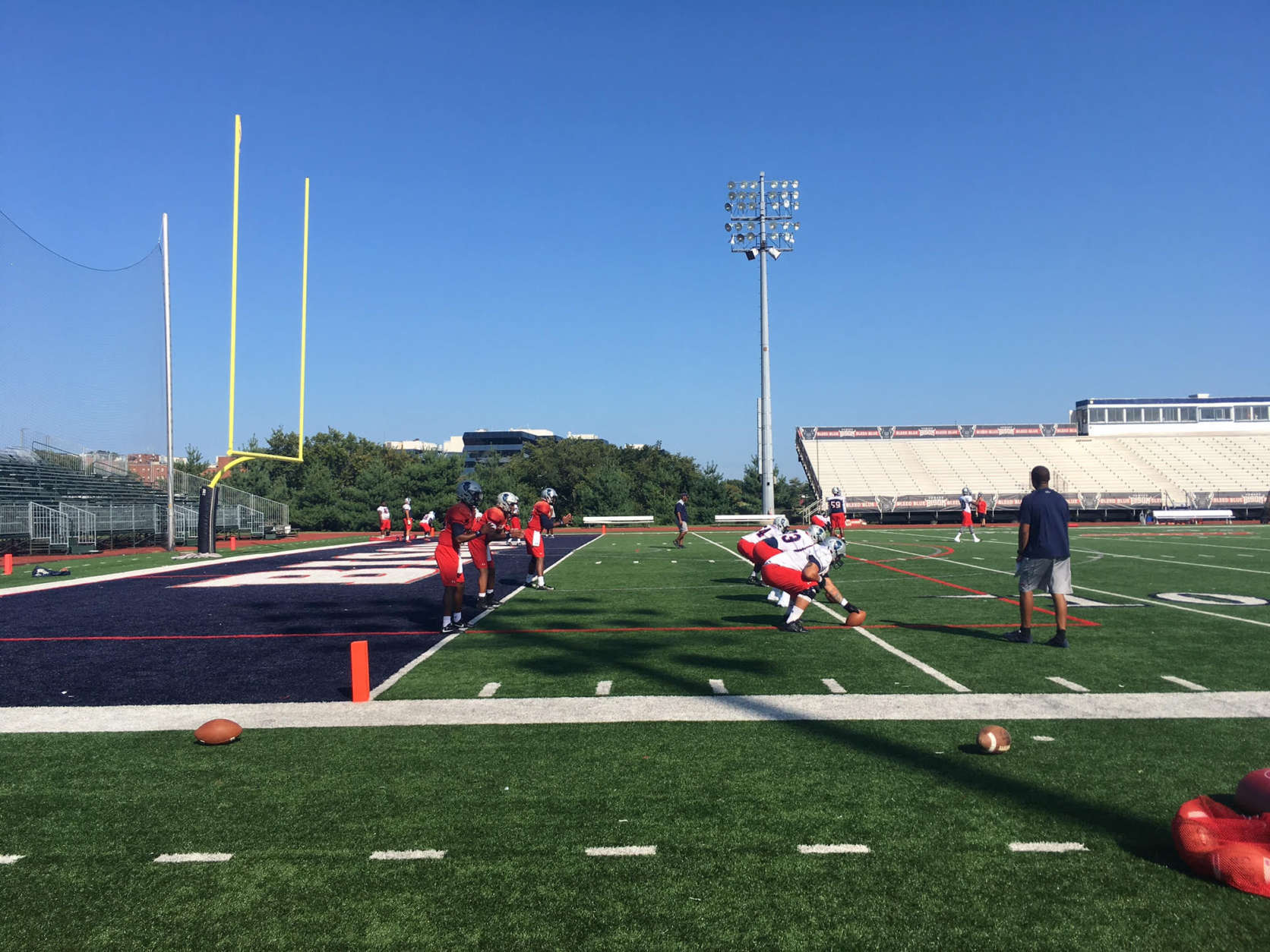 Quarterback Caylin Newton (#3, middle, in red) won the starting quarterback job as a true freshman. (WTOP/Noah Frank)