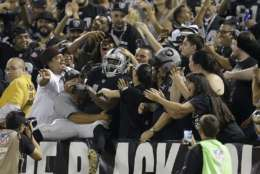 Oakland Raiders running back George Atkinson III (45) celebrates with fans during the second half of an NFL preseason football game against the Seattle Seahawks in Oakland, Calif., Thursday, Aug. 31, 2017. Atkinson had scored an apparent touchdown that called back on penalty. (AP Photo/Ben Margot)
