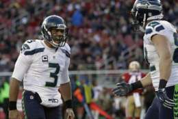 Seattle Seahawks quarterback Russell Wilson (3) and tight end Luke Willson, right, celebrate after connecting on a touchdown pass against the San Francisco 49ers during the first half of an NFL football game in Santa Clara, Calif., Sunday, Jan. 1, 2017. (AP Photo/Marcio Jose Sanchez)