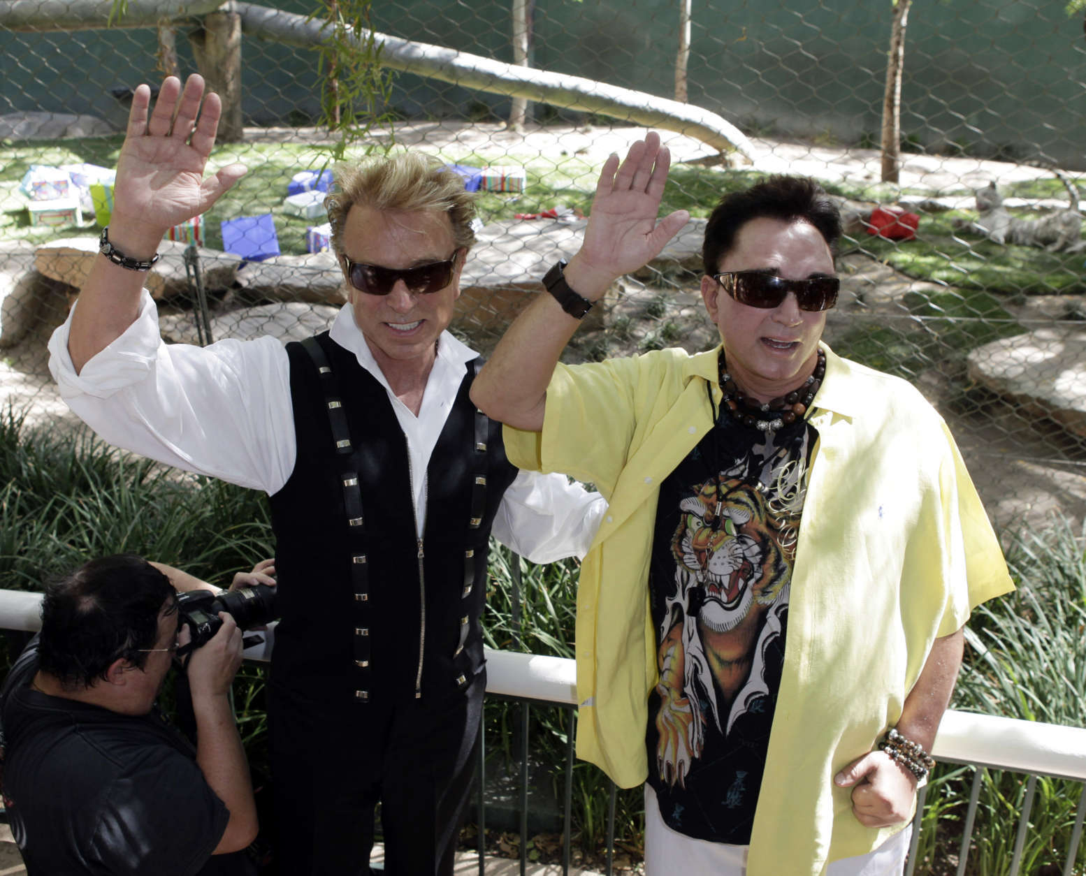 Siegfried Fischbacher, left, and Roy Horn pose for photos as they celebrate their tiger cubs' first birthday at Secret Garden & Dolphin Habitat at the Mirage hotel and casino in Las Vegas, Tuesday, May 12, 2009.  (AP Photo/Jae C. Hong)