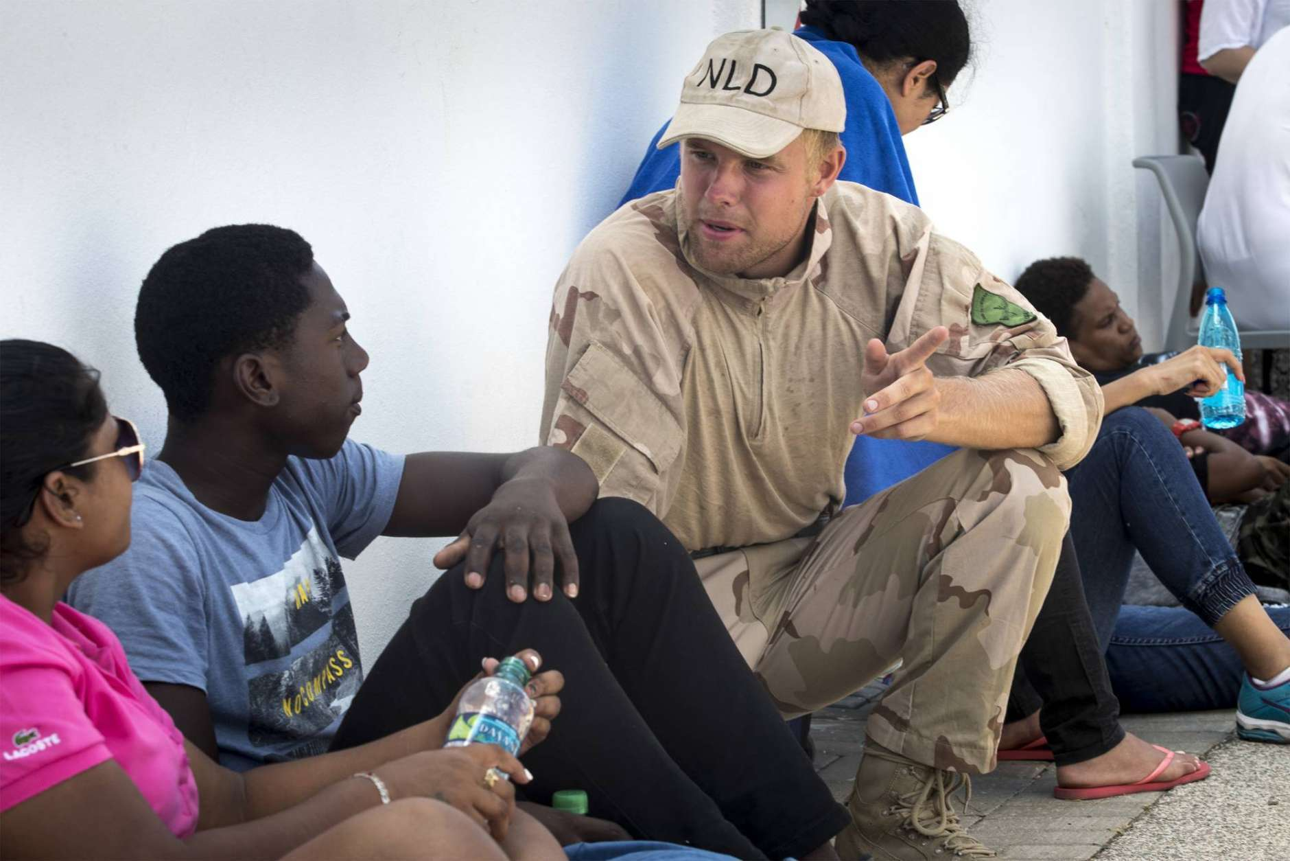 This photo provided by the Dutch Defense Ministry shows a Dutch soldier talking to residents after the passing of Hurricane Irma, in Dutch Caribbean St. Maarten, on Monday Sept. 11, 2017. Dutch King Willem-Alexander said the scenes of devastation he witnessed on the Caribbean island of St. Martin in the aftermath of Hurricane Irma are the worst he has ever seen. (Gerben Van Es/Dutch Defense Ministry via AP)